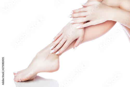 Foto op Canvas Pedicure irl legs and hands, manicure pedicure, smooth healthy skin. Isolated. White background. Copy space