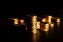 Stack Of Gold Coin On Black Background.