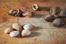 Apricot Kernel On Wooden Background, Split Bones, Apricot Kernels.