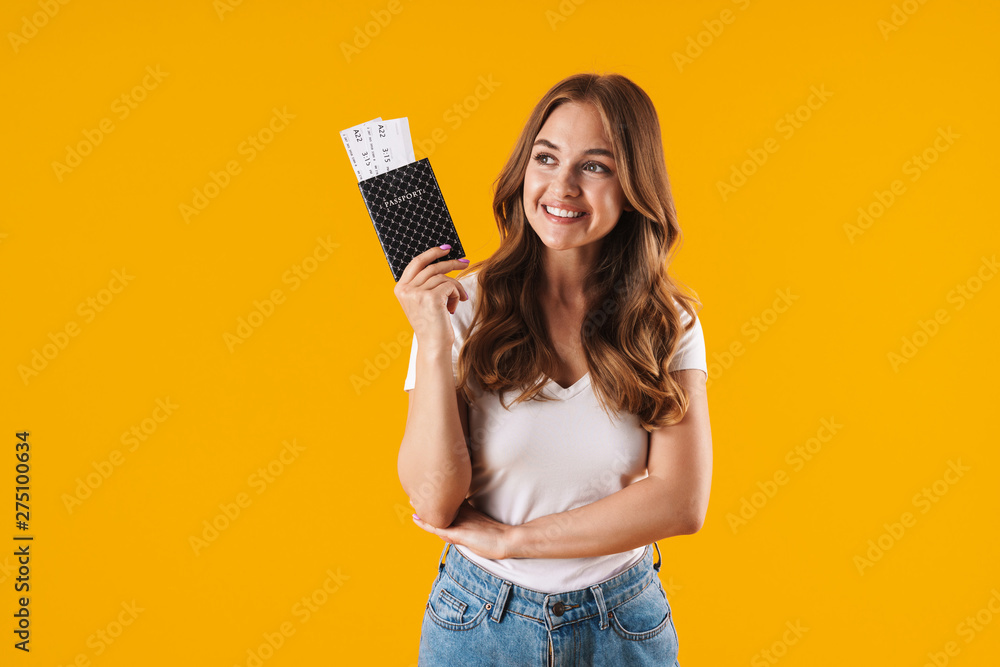 Fototapety, obrazy: Photo of positive young woman smiling while holding passport and travel tickets