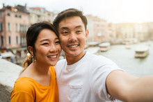 Loving Couple On Vacation In Venice, Italy - Millennials Take A Selfie On The Famous Rialto Bridge