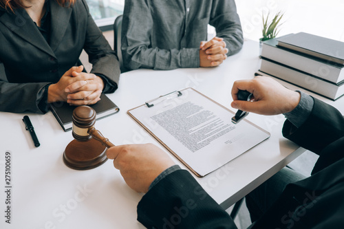 Photo  smart lawyer holding stamp for submit documents  with advice in the office befor