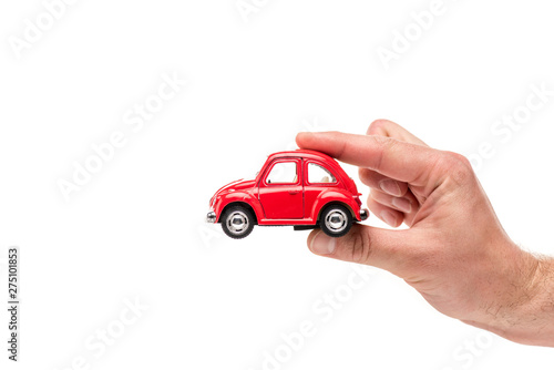 cropped view of man holding red toy car on white