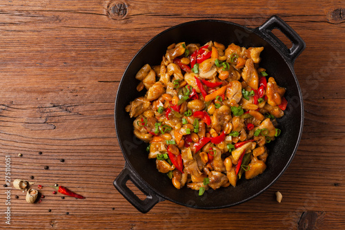 Chicken kung pao. Fried chicken pieces with peanuts and peppers. Wallpaper Mural