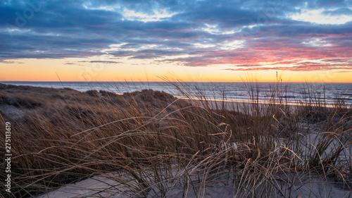 Tranquil and colorful sunset at the beach in Grønhoj Strand near Løkken, Denmark Canvas Print