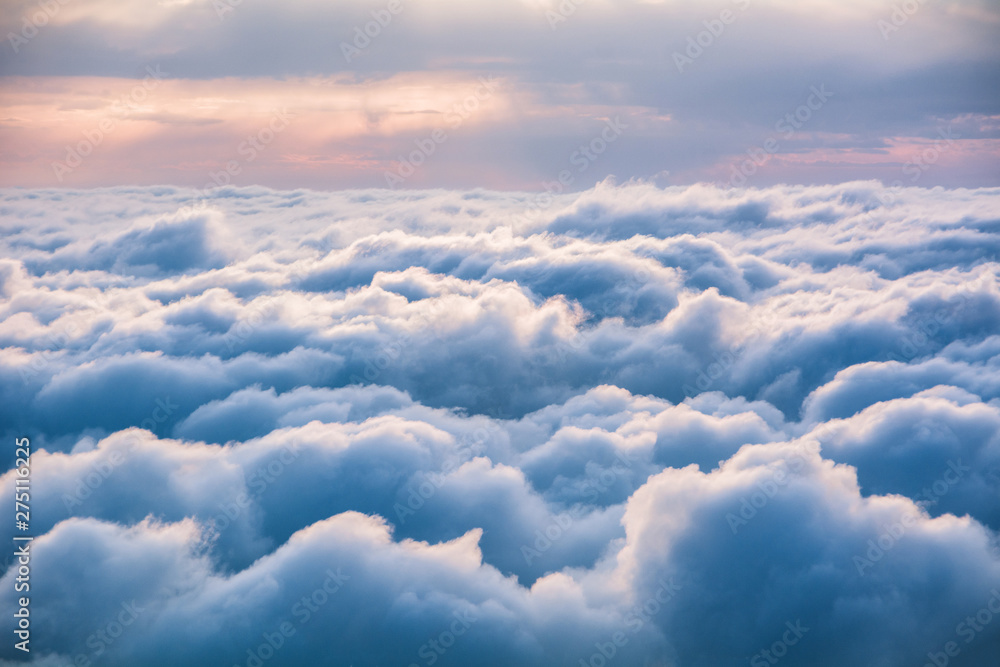 Fototapeta View of the clouds from above at dawn