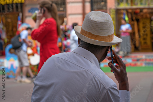 Spoed Fotobehang Japan African American in Russia talking on a cell phone.