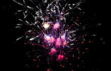 Colorful Fireworks In The Sky On Black Background