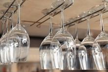 Set Of Empty Clean Glasses On Bar Racks