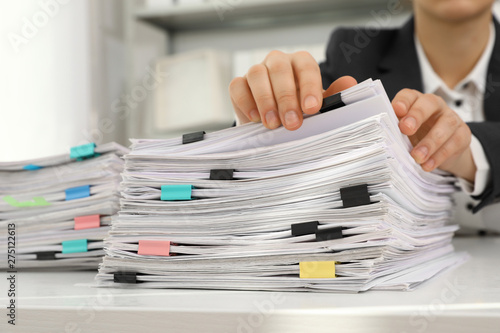 Woman working with documents at table in office, closeup Wallpaper Mural
