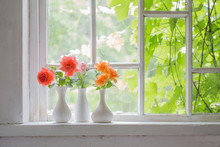 Beautiful Roses In Vases On Old Wooden Windowsill