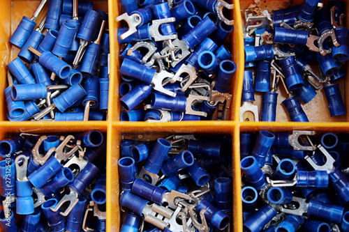 Fotomural  Blue connectors separated by orange tool box