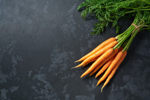 Bunch Of Fresh Carrots On Black Background, Top View