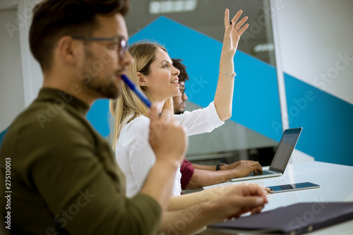 Woman raised her hand up for question in conference meeting Tableau sur Toile
