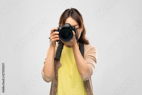 Kiev photography, profession and people and concept - asian female photographer with digital camera