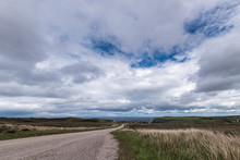 The A836 Between Bettyhill And Strath, Part Of The North Coast 500 In Sutherland, Scotland. The Orkney Islanda Are In The Distance.