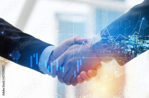 Fotografía  business man shaking hand with graph chart of stock market investment trading fo