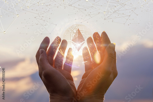 Fototapeta Hands of a business woman showing ethereum . obraz