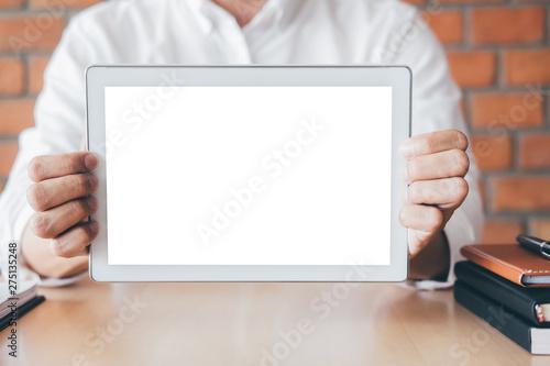 Fotografia  Tablet horizontal screen mockup, Image of Young man holding digital tablet showi