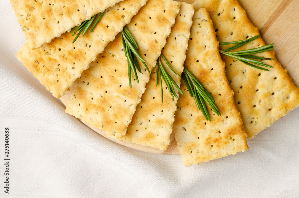 Fototapeta Rosemary gluten free crackers on white background with copy space.