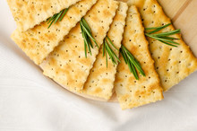 Rosemary Gluten Free Crackers On White Background With Copy Space.