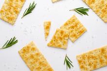 Italian Crunchy Rosemary Crackers On White Background. Flat Lay, Overhead Shot.