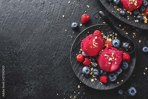 Fototapeta Berry refreshing ice cream scoops on plate obraz