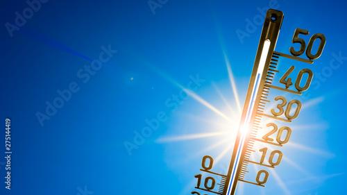 Obraz na plátně  Hot summer or heat wave background, bright sun on blue sky with thermometer