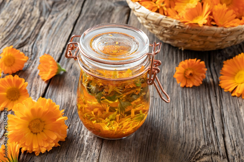 Obraz Preparation of tincture from fresh calendula flowers - fototapety do salonu