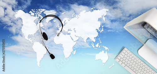 contact concept , top view desk with headset, computer isolated on sky background, international booking concept