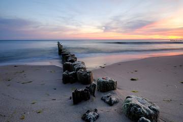 Fototapeta Do restauracji Wschód słońca na wybrzeżu Morza Bałtyckiego,Kołobrzeg,Polska.