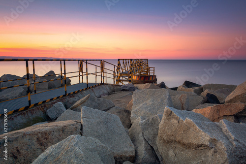 Photo sur Aluminium Ligurie A rocky breakwater overlooking the gulf of Gdansk near the beach at Westerplatte at sunset. Gdansk, Poland