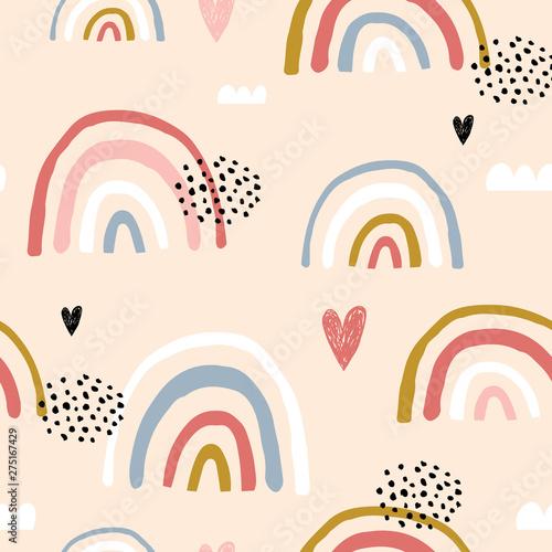 Photo  Seamless childish pattern with hand drawn rainbows and hearts,