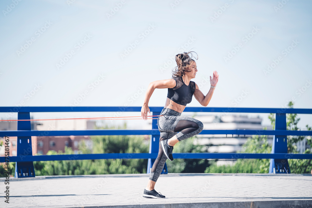 Fototapety, obrazy: Two beautiful twin sisters training muscles with elastic bands