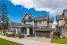 Beautiful Exterior Of Newly Built Luxury Home. Yard With Green Grass And Landscape.