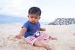 Little baby boy play on the beach