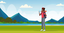 Woman Hiker With Backpack Drin...