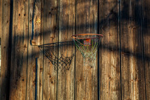 Shabby Basketball Hoop On A Weathered Wooden Wall