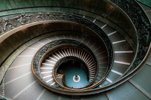 spiral staircase in city Wallpaper Mural