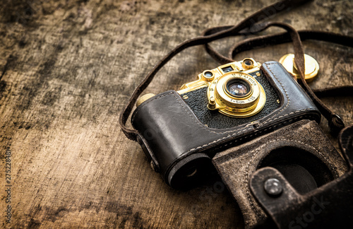 Old vintage film photo camera Vintage toned picture - 275228481