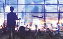 Double Exposure Silhouettes Of Passenger Walking At Airport With People. Business Airline Concept...