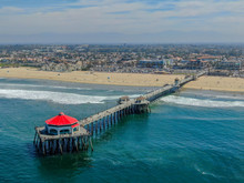 Aerial View Of Huntington Pier, Beach & Coastline During Sunny Summer Day, Southeast Of Los Angeles. California. Destination For Surfer And Tourist.