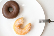 Glazed Donut And Chocolate Donut On White Background