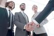 Leinwandbild Motiv business leader shaking hands with the investor