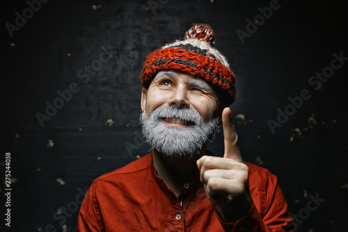 Fotografiet  brutal bald bearded man / studio isolate, photo guy with a gray beard, bald head