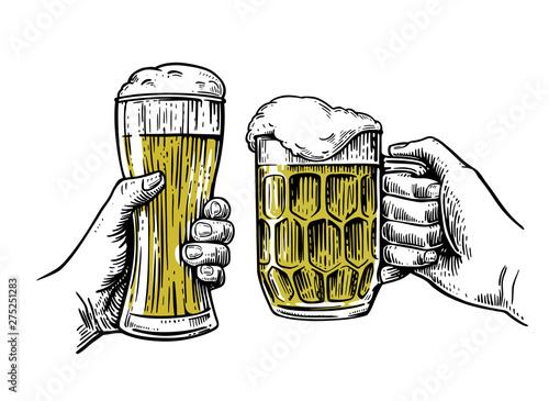 Fotografija two glass beer mugs isolated on white