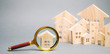 Leinwanddruck Bild - Magnifying glass and wooden houses. House searching concept. Home appraisal. Property valuation. Choice of location for the construction. Search for housing, apartments. Real estate appraiser services