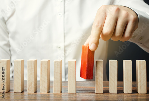 Fototapeta Businessman holds a wooden block in his hands. The concept of personnel selection and management within the team. Dismissal and hiring people to work. Human Resource Management. Leader selection obraz