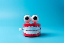 Plastic Toy Teeth On Blue Back...