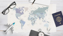 Concept Of Travel Organization. Airplane Model, Passport, Compass, Glasses, Pad And Pencil On World Map. Copy Space In The Middle. Top View, Flat Lay.